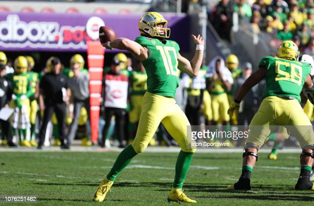 Oregon Ducks quarterback Justin Herbert in passing motion to pass to one of his open receivers during the Redbox Bowl game between the Michigan State...