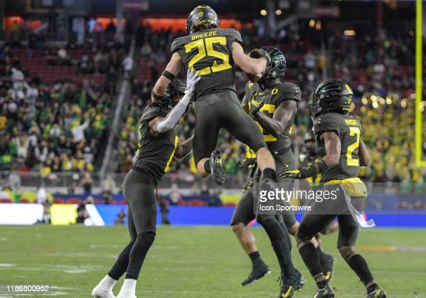 Oregon Ducks safety Brady Breeze leaps up in the air to celebrate a interception in the first quarter during the Pac-12 Championship game between the...