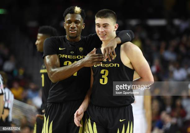 Oregon Dylan Ennis comforts Oregon Payton Pritchard after being flagrant fouled hard in the back by USC Chimezie Metu during a men's college...
