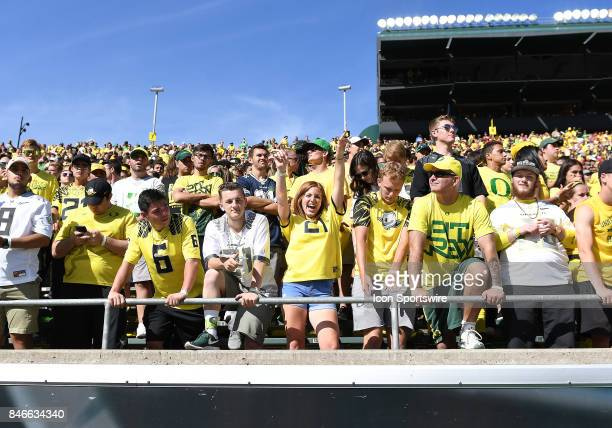 Oregon fans cheer from the stands during a college football game between the Nebraska Cornhuskers and Oregon Ducks on September 9 at Autzen Stadium...