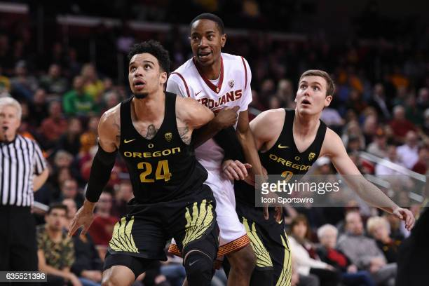 Oregon forward Dillon Brooks boxes out USC guard Shaqquan Aaron during a college basketball game between the Oregon Ducks and the USC Trojans on...