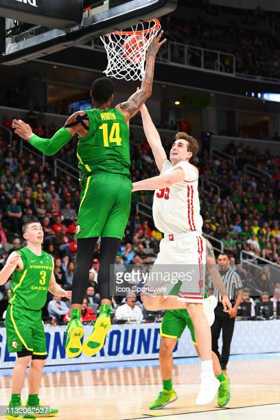 Oregon forward Kenny Wooten jumps to block Wisconsin forward Nate Reuvers shot during the game between the Wisconsin Badgers and the Oregon Ducks in...