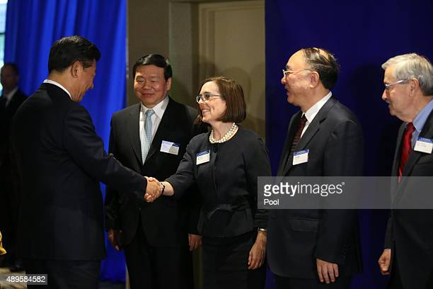 Oregon Gov Kate Brown greets Chinese President Xi Jinping before a forum for US And Chinese governors September 22 2015 in Seattle Washington Xi is...