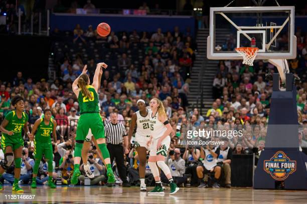Oregon guard Sabrina Ionescu is fouled while making a three point shot in 2019 NCAA Women's Division I Championship Final Four game between the...