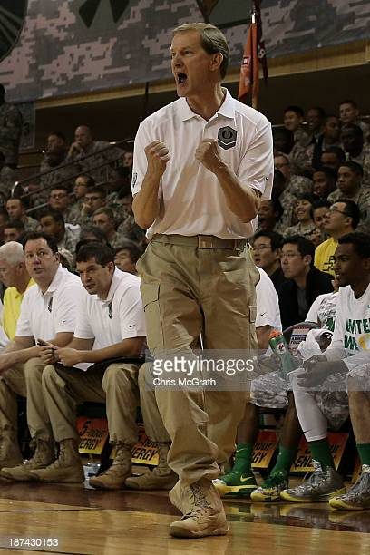 Oregon head coach Dana Altman celebrates a basket against the Georgetown Hoyas during the Armed Forces Classic at United States Army...