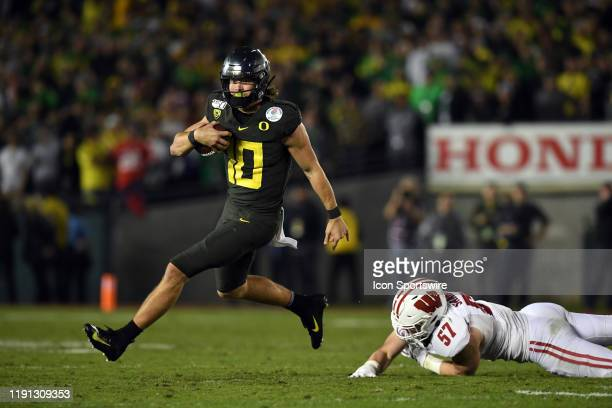 Oregon Justin Herbert runs the ball for a touchdown during the Rose Bowl Game between the Oregon Ducks and the Wisconsin Badgers on January 01 at the...