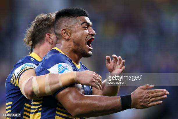 Oregon Kaufusi of the Eels celebrates scoring a try during the round 6 NRL match between the Parramatta Eels and Wests Tigers at Bankwest Stadium on...