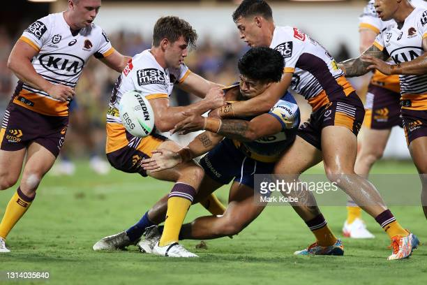 Oregon Kaufusi of the Eels passes as he is tackled during the round seven NRL match between the Parramatta Eels and the Brisbane Broncos at TIO...