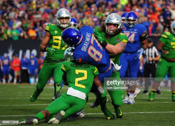 Oregon linebacker La'Mar Winston Jr and safety Tyree Robinson tackle Boise State tight end Alec Dhaenens on the one yard line in the second half of...