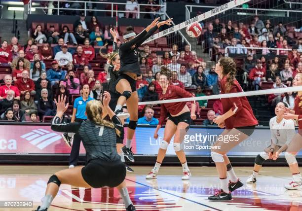 Oregon middle blocker Lauren Page flips the ball back over the net during the regular season game between the Oregon Ducks verses the Stanford...