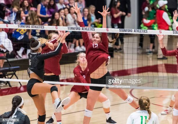 Oregon middle blocker Lauren Page gets a hit through Stanford middle blocker Audriana Fitzmorris for the point during the regular season game between...