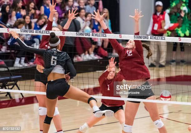 Oregon middle blocker Lauren Page successfully strikes past Stanford middle blocker Audriana Fitzmorris for a score during the regular season game...