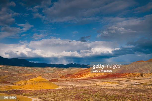 usa, oregon, mitchell, painted hills with storm clouds - fossil site stock pictures, royalty-free photos & images