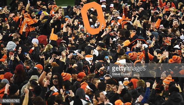Oregon State Beavers fans storm the field after the Beavers defeated the Oregon Ducks during the fourth quarter of the game at Reser Stadium on...