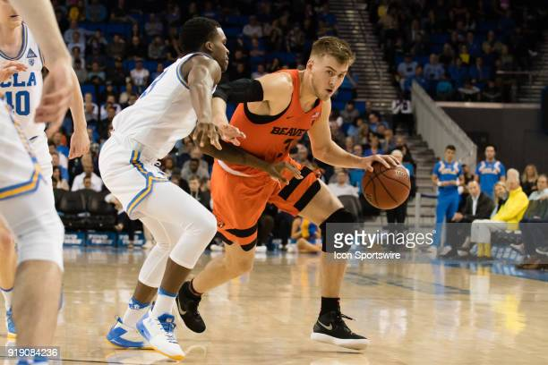 Oregon State Beavers forward Tres Tinkle drives the ball around UCLA Bruins guard Kris Wilkes during the game between the Oregon State Beavers and...