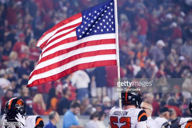 Oregon State Beavers offensive lineman Sumner Houston holds the US flag during a college football game between the Oregon State Beavers and Arizona...