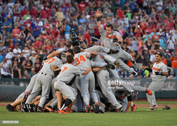 Oregon State Beavers players leap into a dog pile celebrating after defeating the Arkansas Razorbacks for the National Championship during the...