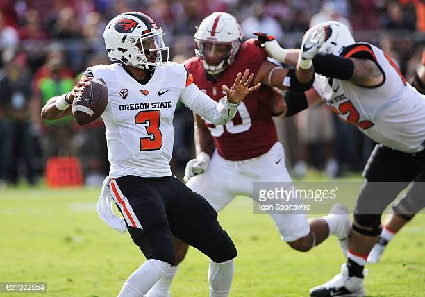 Oregon State Beavers quarterback Marcus McMaryion keeps cool in the pocket while under a heavy pass rush fron the Stanford Cardinal pass rush during...