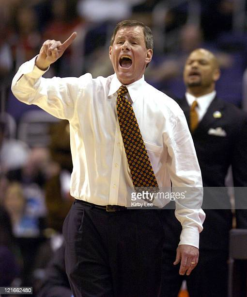 Oregon State coach Jay John shouts instructions during 7972 firstround victory over UCLA in the Pacific Life Pac10 men's basketball tournament at the...