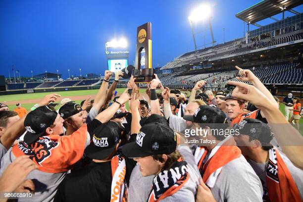Oregon State hoists the national championship trophy following game 3 of the Division I Men's Baseball Championship held at TD Ameritrade Park on...