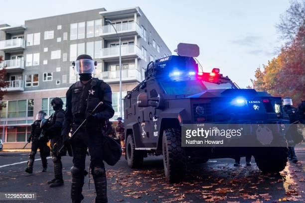 "Oregon State Police and Salem Police block a street during dueling Black Lives Matter and ""Stop the Steal"" protests on November 7, 2020 in Salem,..."