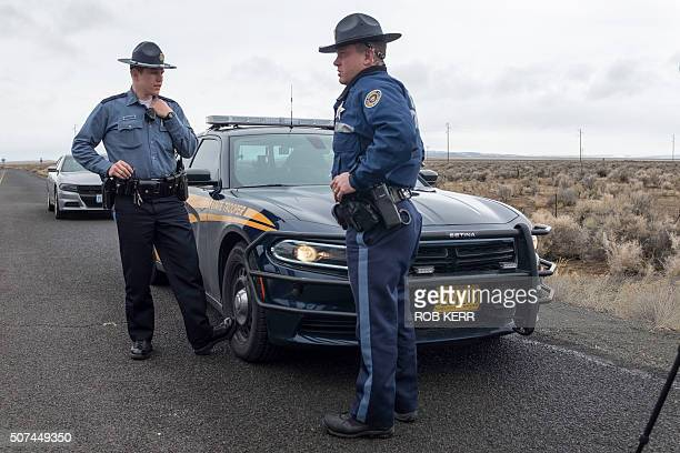 Oregon State Police monitor a checkpoint near the Malheur Wildlife Refuge near Burns Oregon on January 29 2016 Eleven people including Bundy have...