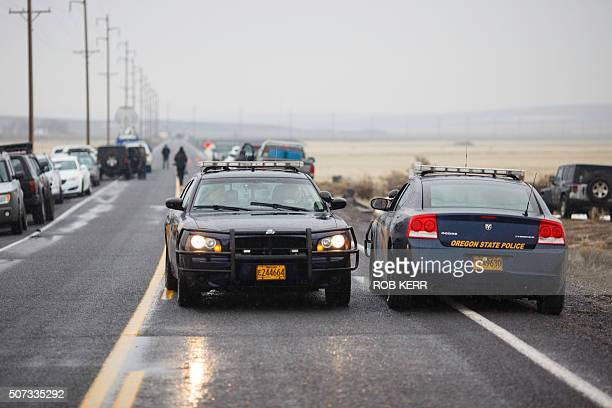 Oregon State Police monitor stopped traffic on Highway 78 located approximately 4 miles from the Malheur Wildlife Refuge Headquarters near Burns...