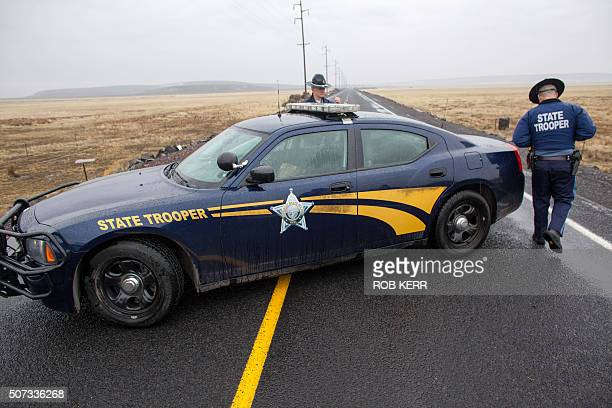 Oregon State Police officers monitor a closed area at a road checkpoint on Highway 78 approximately 4 miles from the Malheur Wildlife Refuge...