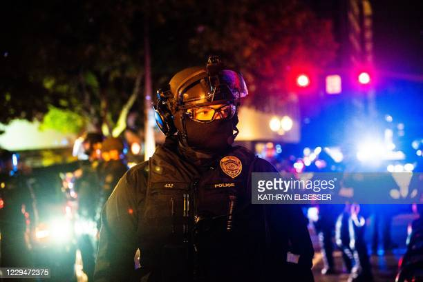 """Oregon State Troopers block a street as they confront protesters in Portland, Oregon on November 4 during a demonstration called by the """"Black Lives..."""