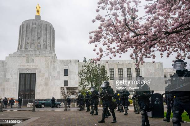 Oregon State Troopers disperse a crowd of anti-fascist protesters on March 28, 2021 in Salem, Oregon. Anti-fascist protesters clashed with vehicles...