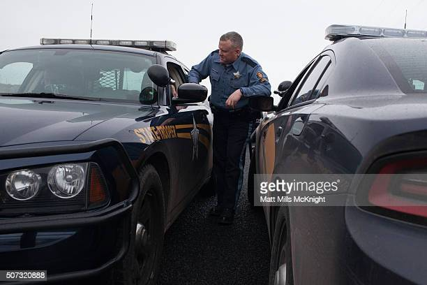 Oregon State Troopers talk near a checkpoint at the Malheur National Wildlife Refuge January 28 2016 near Burns Oregon On January 26 eight protestors...