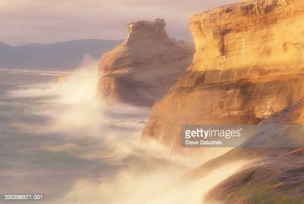 USA, Oregon, waves and spray on rocky coastline