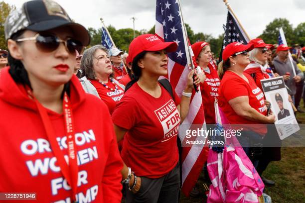 Oregon Women for Trump carry signs and flags as the Proud Boys a rightwing proTrump group gather with their allies in a rally called âEnd Domestic...