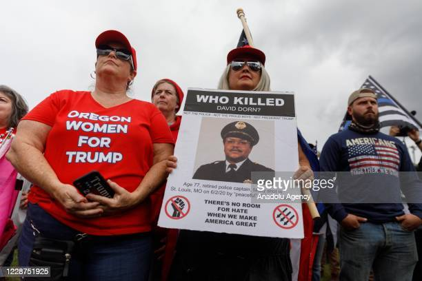 Oregon Women for Trump carry signs as the Proud Boys a rightwing proTrump group gather with their allies in a rally called âEnd Domestic Terrorismâ...