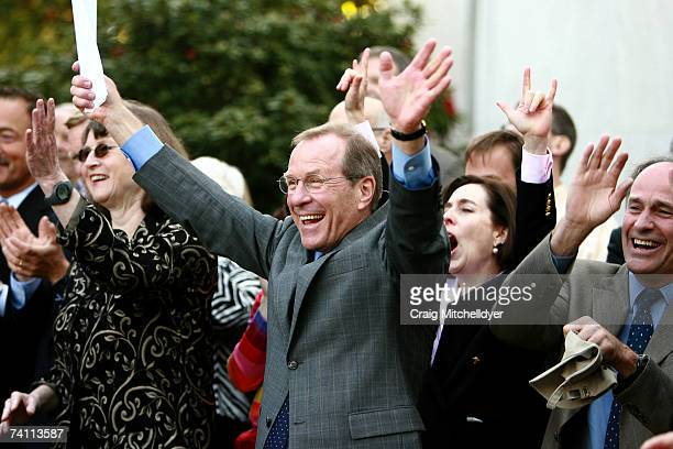 Oregon's Democratic Governor Ted Kulongoski Sen Kate Brown and Secretary of State Bill Bradbury cheer prior to signing two bills protecting gay...