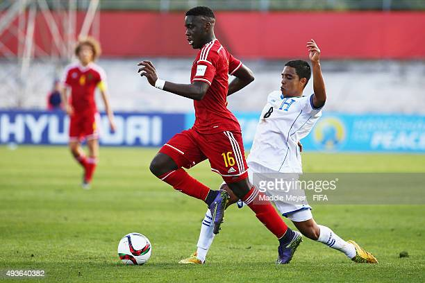 Orel Mangala of Belgium carries the ball with pressure from Erick Arias of Honduras during the FIFA U17 World Cup Chile 2015 group D match between...