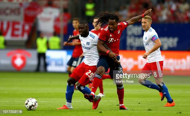 Orel Mangala of Hamburg and Renato Sanches of Muenchen battle for the ball during the Friendly match between Hamburger SV FC Bayern Muenchen at...