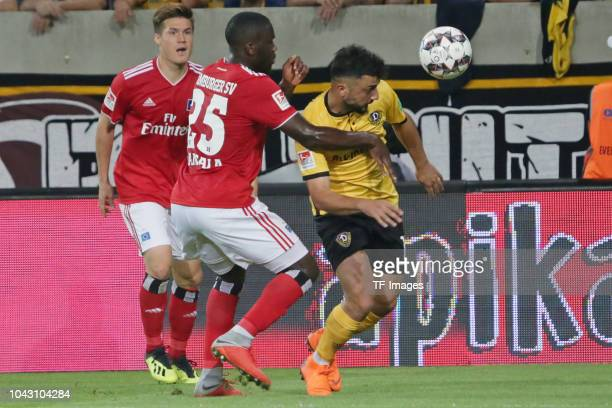 Orel Mangala of Hamburger SV and Aias Aosman of Dynamo Dresden battle for the ball during the Second Bundesliga match between SG Dynamo Dresden and...