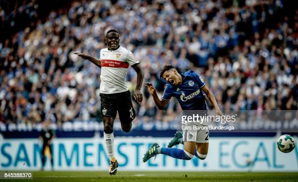 Orel Mangala of Stuttgart challenges Amine Harit of Schalke during the Bundesliga match between FC Schalke 04 and VfB Stuttgart at VeltinsArena on...