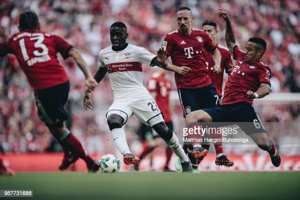 Orel Mangala of Stuttgart is challenged by Thiago Alcantara of FC Bayern Muenchen during the Bundesliga match between FC Bayern Muenchen and VfB...