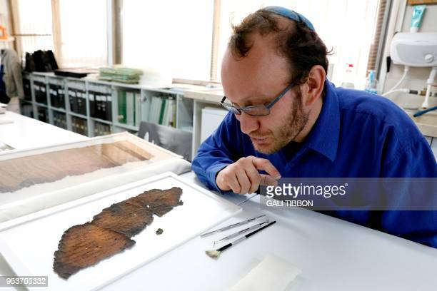 Oren Ableman a Dead Sea scrolls researcher of the Israel Antiquities Authority who examined scroll fragments with the aid of advanced imaging...