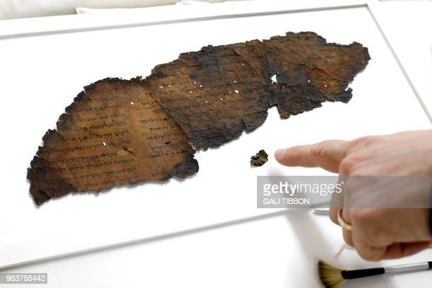 Oren Ableman, a Dead Sea scrolls researcher of the Israel Antiquities Authority -- who examined scroll fragments with the aid of advanced imaging...
