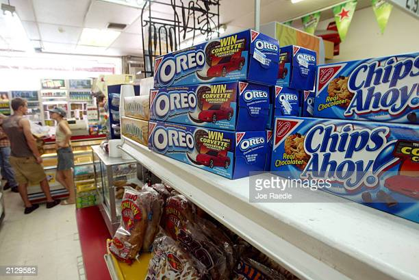 Oreo and Chips Ahoy cookies are displayed on a store shelf July 1 2003 in Miami Florida Kraft Foods Inc the nations largest food manufacturer and the...
