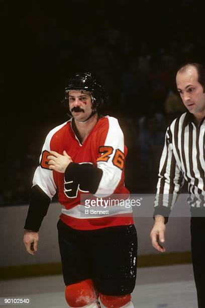 Orest Kindrachuk of the Philadelphia Flyers leaves the ice with a cut face during a February 1977 game