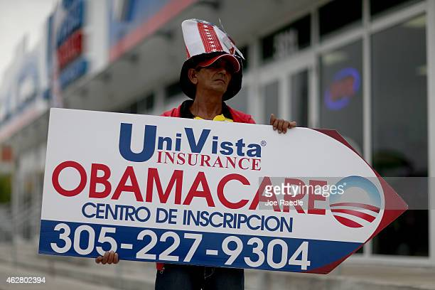 Oreste Alvarez holds a sign directing people to UniVista Insurance company where they can sign up for the Affordable Care Act also known as Obamacare...