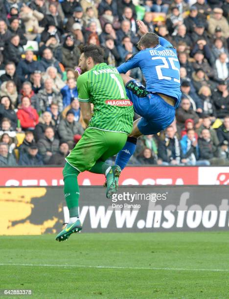 Orestis Karnezis goalkeeper of Udinese Calcio competes with Domenico Berardi of US Sassuolo during the Serie A match between Udinese Calcio and US...