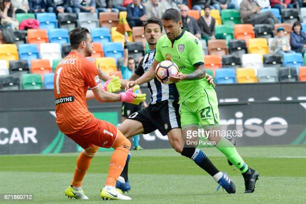 Orestis Karnezis goalkeeper of Udinese Calcio competes with Marco Borriello of Cagliari Calcio during the Serie A match between Udinese Calcio and...