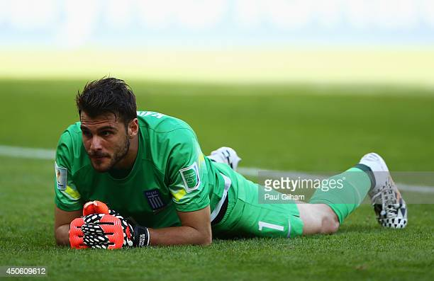 Orestis Karnezis of Greece lies on the field after allowing a third goal to Colombia during the 2014 FIFA World Cup Brazil Group C match between...