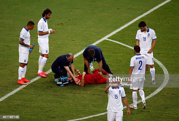 Orestis Karnezis of Greece lies on the field receiving treatment during the 2014 FIFA World Cup Brazil Group C match between Greece and the Ivory...