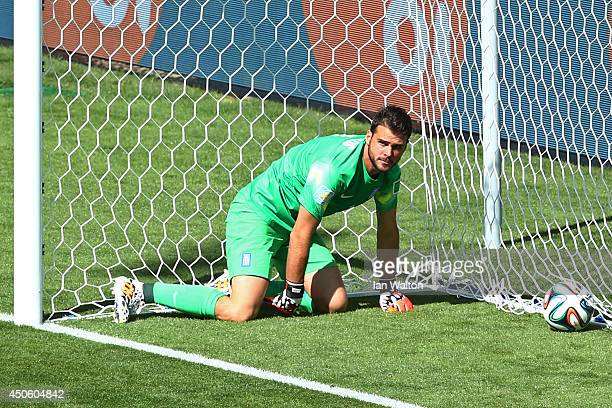 Orestis Karnezis of Greece looks on after failing to save a shot by Pablo Armero of Colombia for their first goal during the 2014 FIFA World Cup...